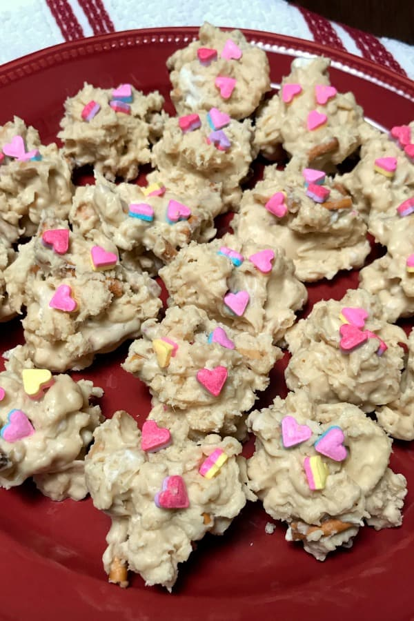 Each year we look for a fun and easy Valentine candy or sweet treat to make.  We love these Valentine Drops with white chocolate, pretzels, crispy rice cereal, peanut butter, and cashews.  These are a great treat for school Valentine parties too! #Valentinesfood
