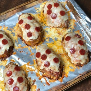 Individual pizza meatloaves covered in pepperoni and cheese
