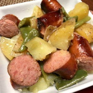 White plate of Smoked Sausage chunks, Potatoes and Green Beans