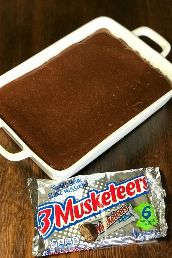 3 MusketeersCake is the perfect dessert for people who LOVE 3 Musketeers candy bars and cake! My husband craves 3 Musketeers Bars, so this is the perfect creamy chocolate cake with more creamy chocolate icing spread on top! #3Musketeers #EasyCake