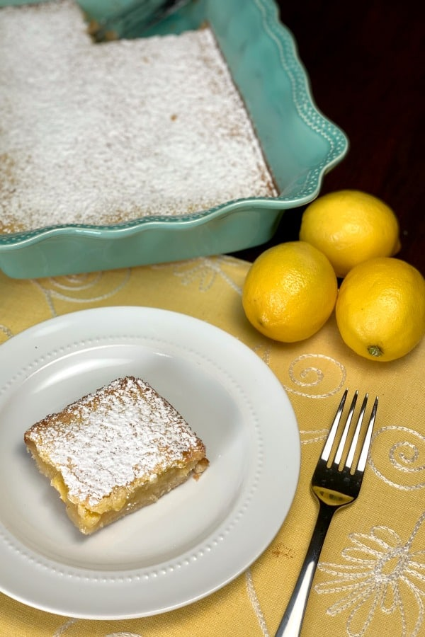 My mother-in-law couldn't stop talking about how amazing these Farmhouse Lemon Bars are. She's right! These are the BEST Lemon Bars I've ever eaten. They are light and sweet with the perfect amount of lemon tang!