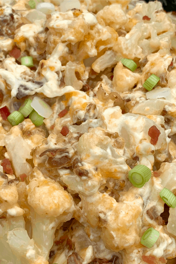 Easy crock pot vegetable side dish with cauliflower, cream cheese, cheddar cheese, mozzarella cheese, bacon and green onions
