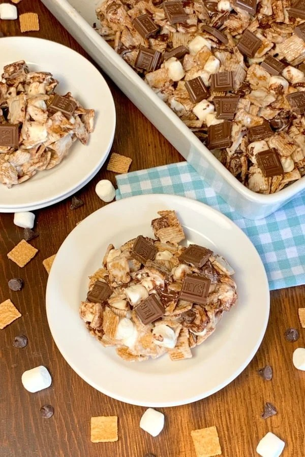Smores Cereal Bar treats on plates with chocolate chips, Golden Grahams and marshmallows