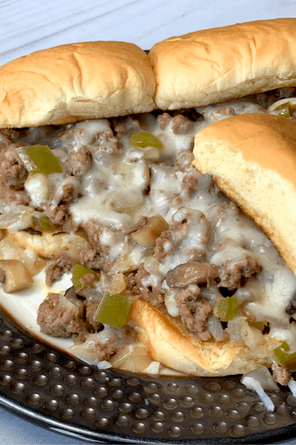 These Philly Cheesesteak Sloppy Joe Sandwiches in the Instant Pot are on repeat on our family menu!  We love the combination of meat and vegetables on an easy sandwich that even our picky eaters enjoy!