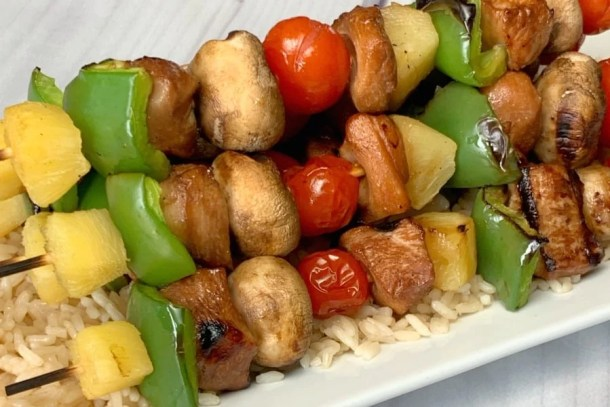 chicken kabobs in sweet and sour marinade with vegetables on skewers