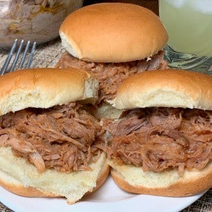 Margarita Monday pulled pork or shredded pork sliders on a plate next to jose cuervo margarita mix