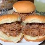 Margarita Monday pulled pork or shredded pork sliders on a plate next to jose cuervo margarita mix