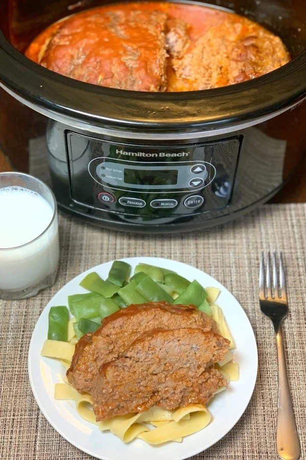 Ground beef, croutons, eggs, milk, applesauce, onion and tomato soup mix together for a really easy, moist, and delicious homemade meatloaf