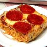 square piece of spaghetti pizza with pepperoni on top