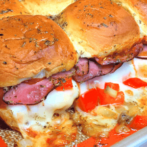 roast beef sliders with provolone cheese on Hawaiian rolls