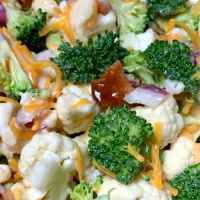 Crunchy broccoli, cauliflower, onion, cheddar cheese and bacon salad with light Miracle Whip based dressing