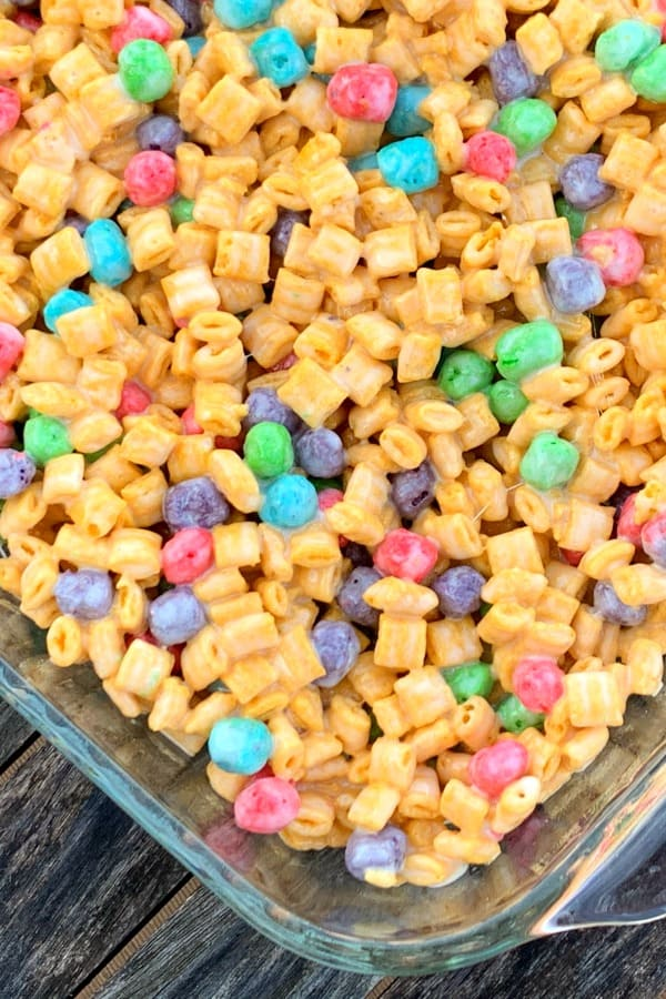 9 x 13 glass pan of Captain Crunch Cereal Snack or Dessert on a worn wooden table