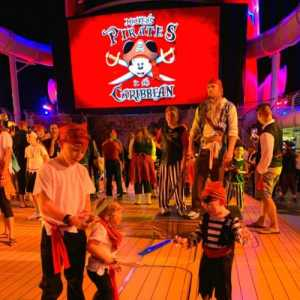 Pirate night on Deck 11 of cruise on Disney Dream in front of funnel vision screen