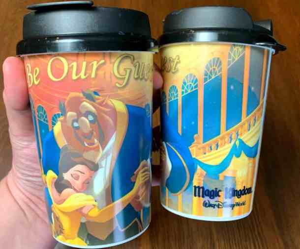 $5 Souvenir cups from Be Our Guest restaurant with Belle and the Beast dancing