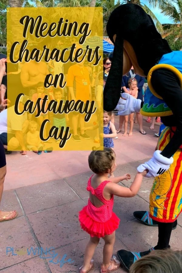 Goofy having a dance party and holding a kid's hand on Castaway Cay