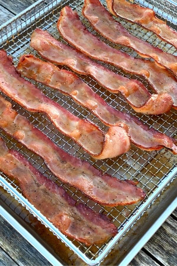 Air fryer basket of brown sugar candied bacon