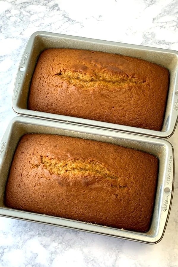 Two loaves of pumkin bread in loaf pans