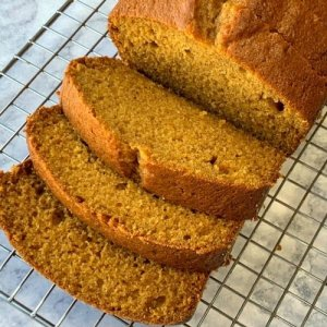 Sliced pumpkin spice bread on cooling rack