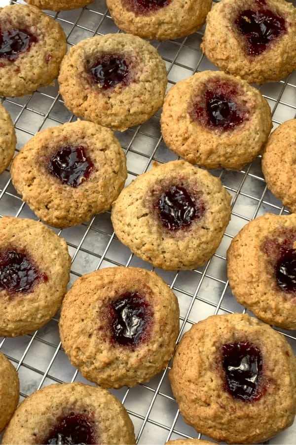 Raspberry Peek a boo cookies on wire cooling rack