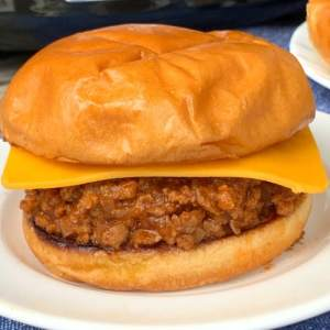 Homemade sloppy joe sandwich on a white plate