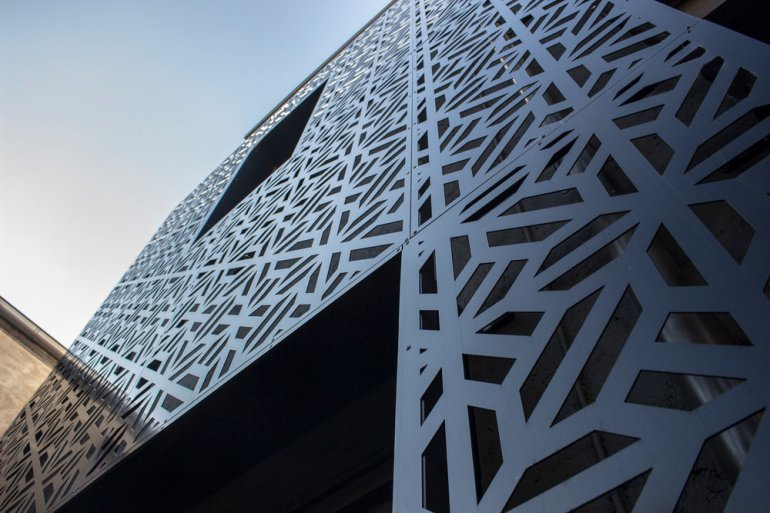 Laser cut building facade by PLR Design