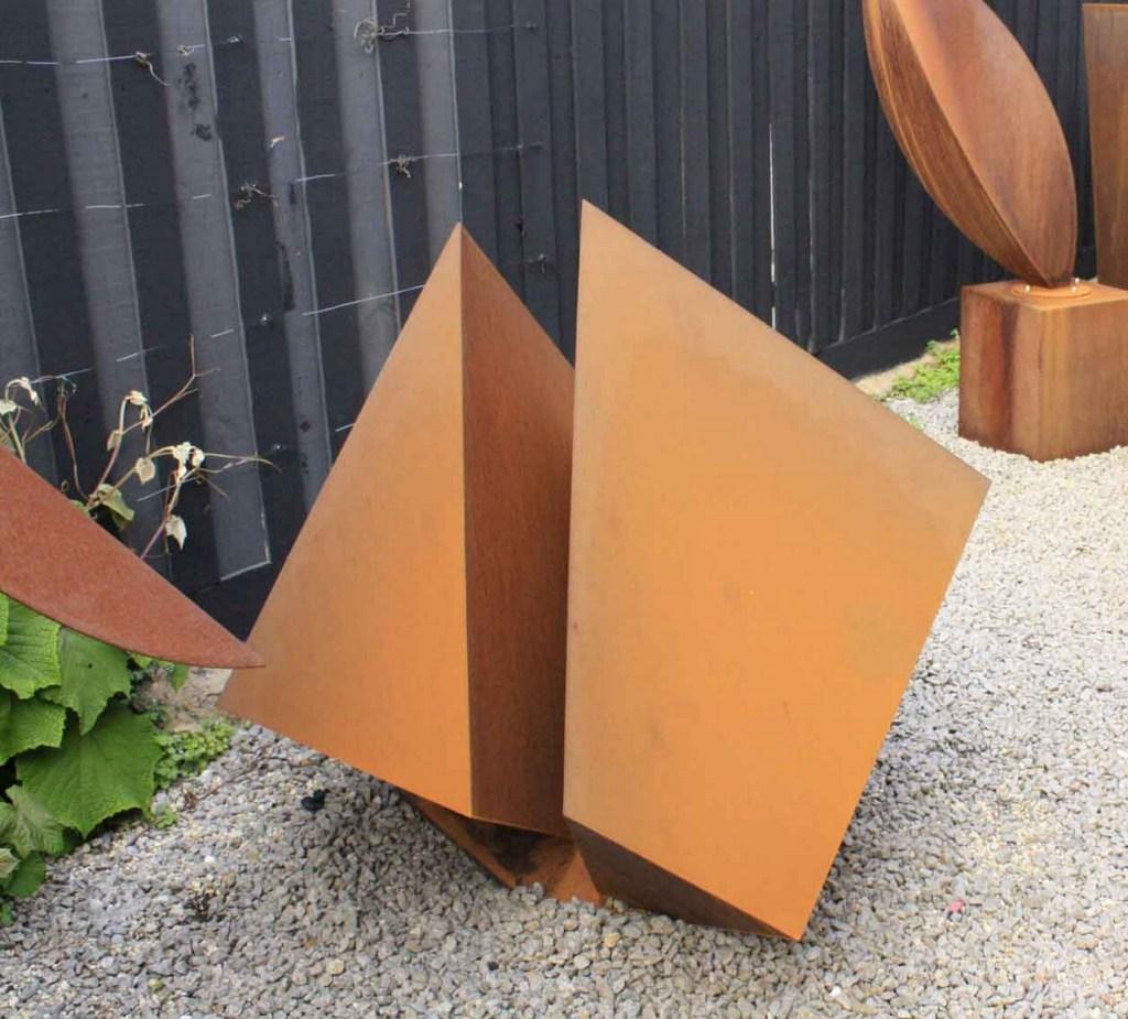 Split cube Corten steel sculpture by PLR Design