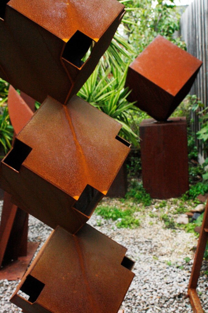 Totem Corten steel sculpture by PLR Design in garden