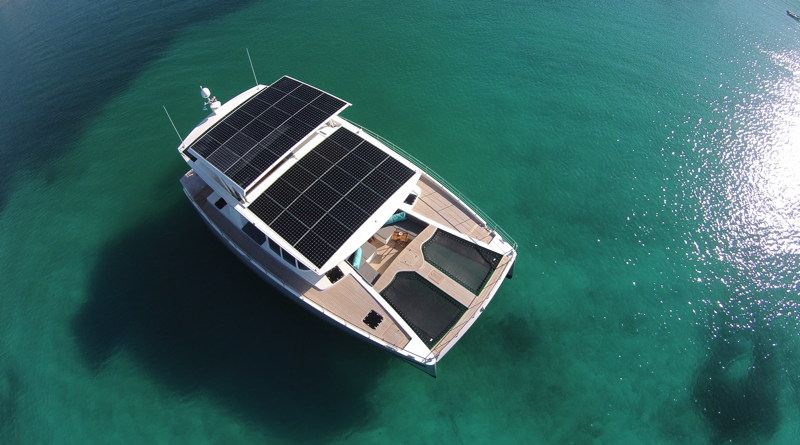 a luxury 64' yacht seen from above with solar panels on its roof