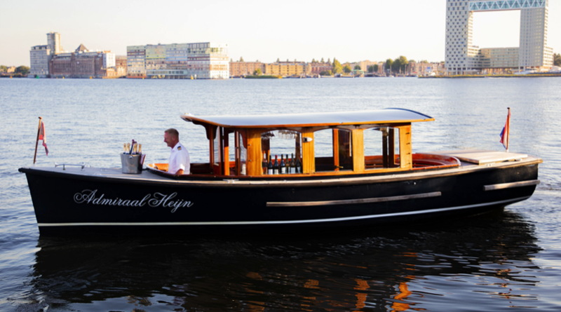 Electrified canal boats of Amsterdam include classic wood salon boats
