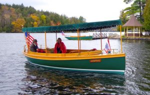 A new photograph of an electric boat with canopy, very much like the historical version