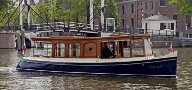 Elisabeth 1910 electric canal boat for rent in Amsterdam