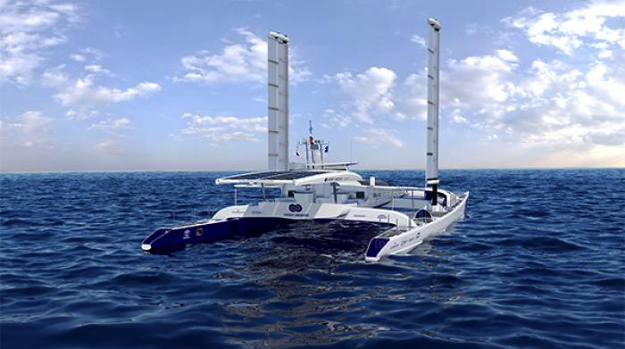 a large trimaran with tall towers on each pontoon that are like square sails