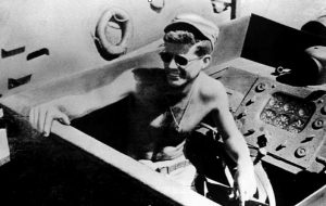 Photograph of John F. Kennedy in the cockpit of PT-109