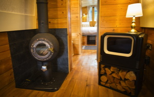 solar electric narrowboat has a spherical fireplace about .75m around and a retro tv cabinet with the screen replaced