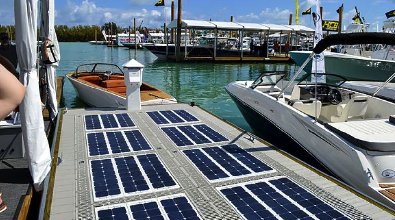 A dock with solar panels on it and a boat beside it