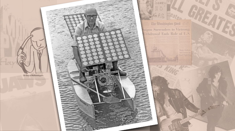 A black and white photograph of a man in a very small boat is in front of a montage of news photos from 1975