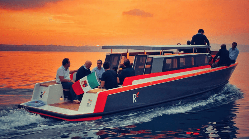 a water taxi holding 12 people rides along at sunset