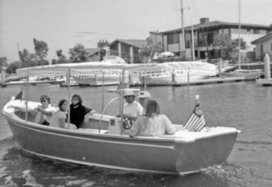 a group of young people in an electric boat in the 1970s