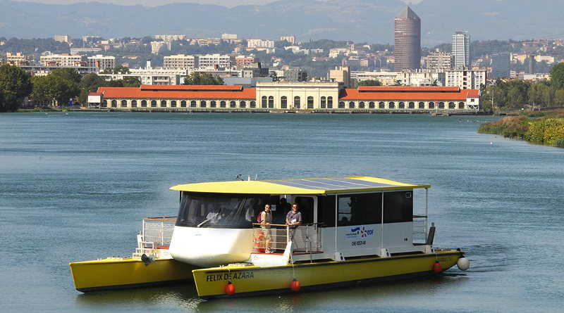 a 17 m solar catamaran on a river in France
