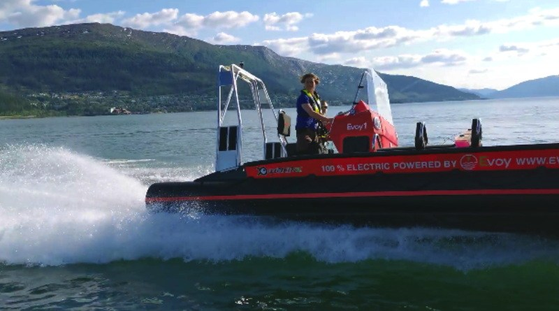 A man driving a 8.5 meter - 28 foot boat with an electric motor