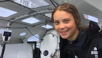 Great Thurnberg smiles inside the cockpit of the low carbon boat Malizia