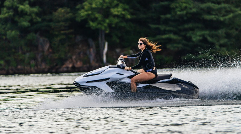 a woman rides along the water on the Orca new electric jetski