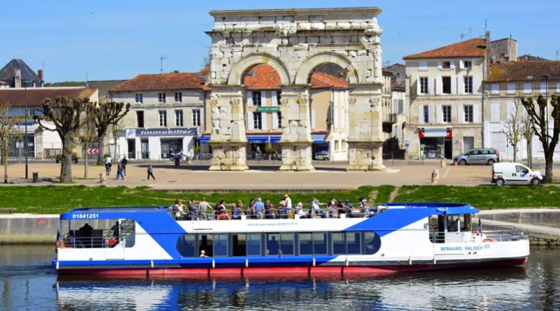 a solar electric ferry cruises along the French riverside