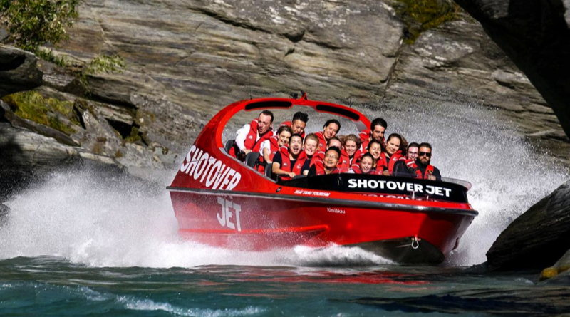 a jetboat with 14 screaming passengers speeds through a New Zealand river gorge