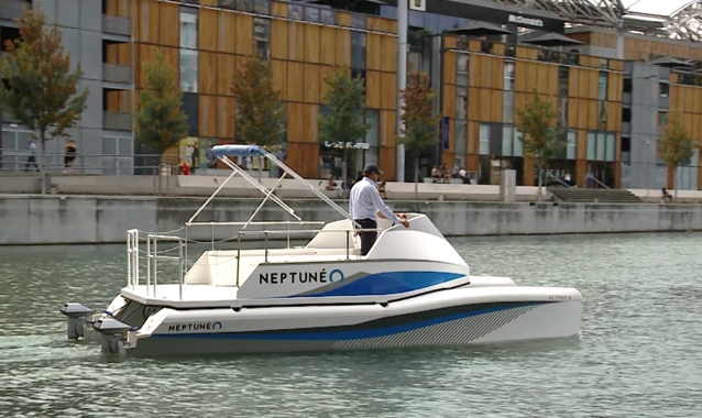 Neptuneo electric catamaran driving along a canal