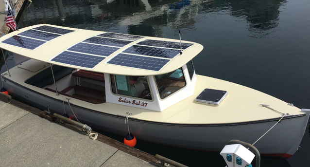 A pilot boat with solar panels on the roof