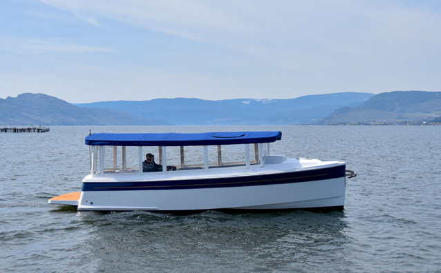Templat electric boat on a lake in British Columbia, Canada