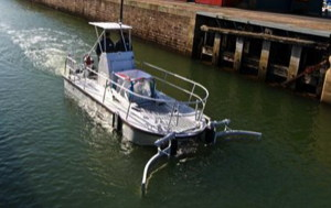 all electric boat with wide catcher at bow to collect waste