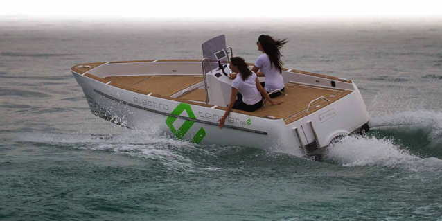 open deck electric boat speeding through the water