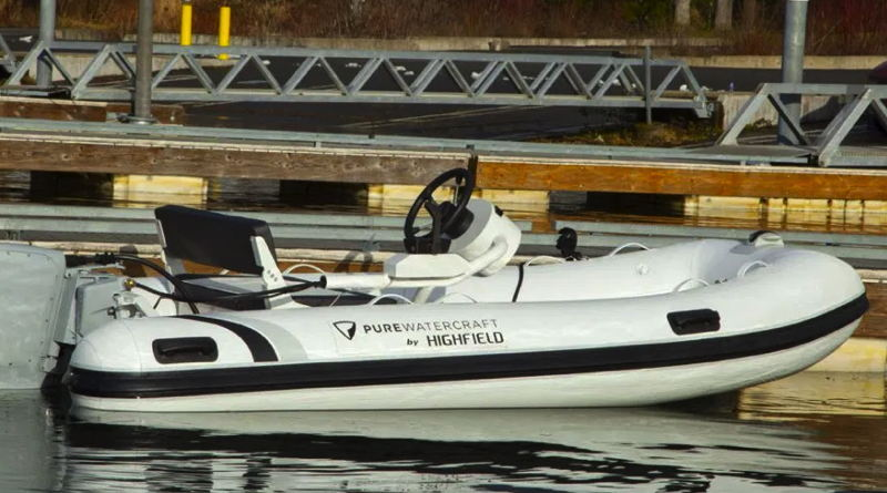 new electric boat package of a Highland RIB with a Pure Watercraft outboard sitting at a dock